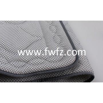 El cubrecolchon de tela de malla ventilable y lavable